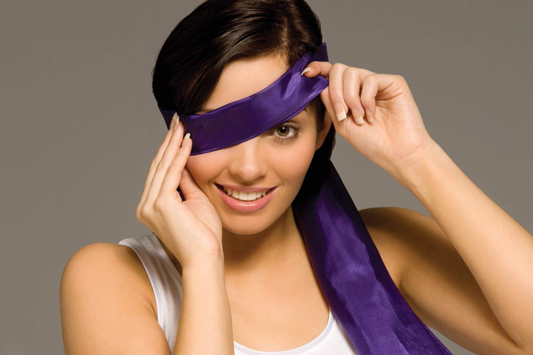 Croda Emulsifier Brunette Female Covering her Face with Purple Silk